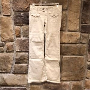 Angels tan stretch flare pants juniors size 5.